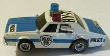 AFX Chevy Police car, white/blue, flashing lights