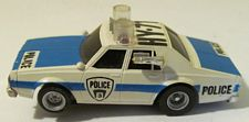 AFX Chevy police car with clear roof light covers