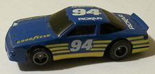 Rokar Olds stocker HO slotcar in blue with yellow and white #94