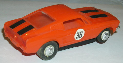 Revell 1/32 orange Mustang, right side view.
